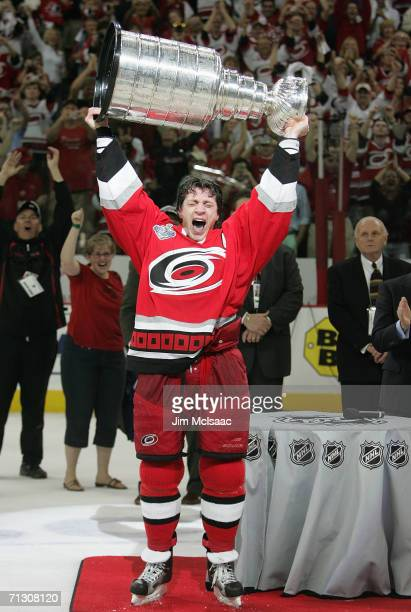 Rod Brind'Amour of the Carolina Hurricanes hoists the Stanley Cup after the Hurricanes defeated the Edmonton Oilers in game seven of the 2006 NHL...