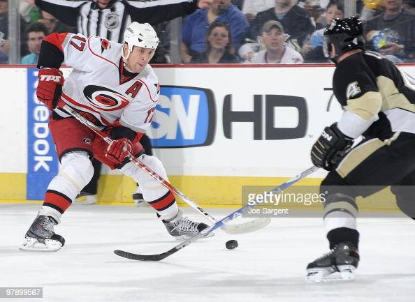 Rod Brind'Amour of the Carolina Hurricanes moves the puck up ice in front of Jordan Leopold of the Pittsburgh Penguins on March 20 2010 at Mellon...