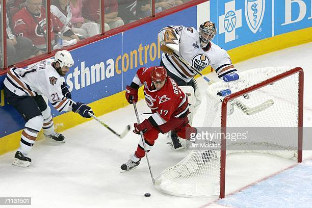 Rod Brind'Amour of the Carolina Hurricanes steals the puck and scores the game winning goal over Jason Smith and goaltender Ty Conklin of the...