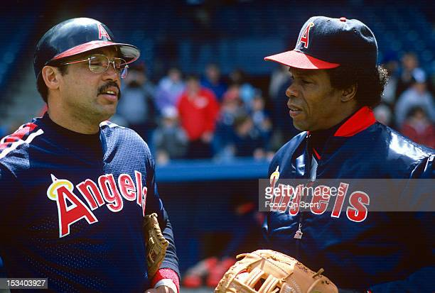 Rod Carew AE and Reggie Jackson of the California Angels talks with each other before an Major League Baseball against the New York Yankees game...