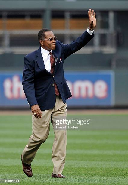 Rod Carew member of the Baseball Hall of Fame walks onto the field for a ceremony to retire Bert Blyleven's number before a game between the Kansas...