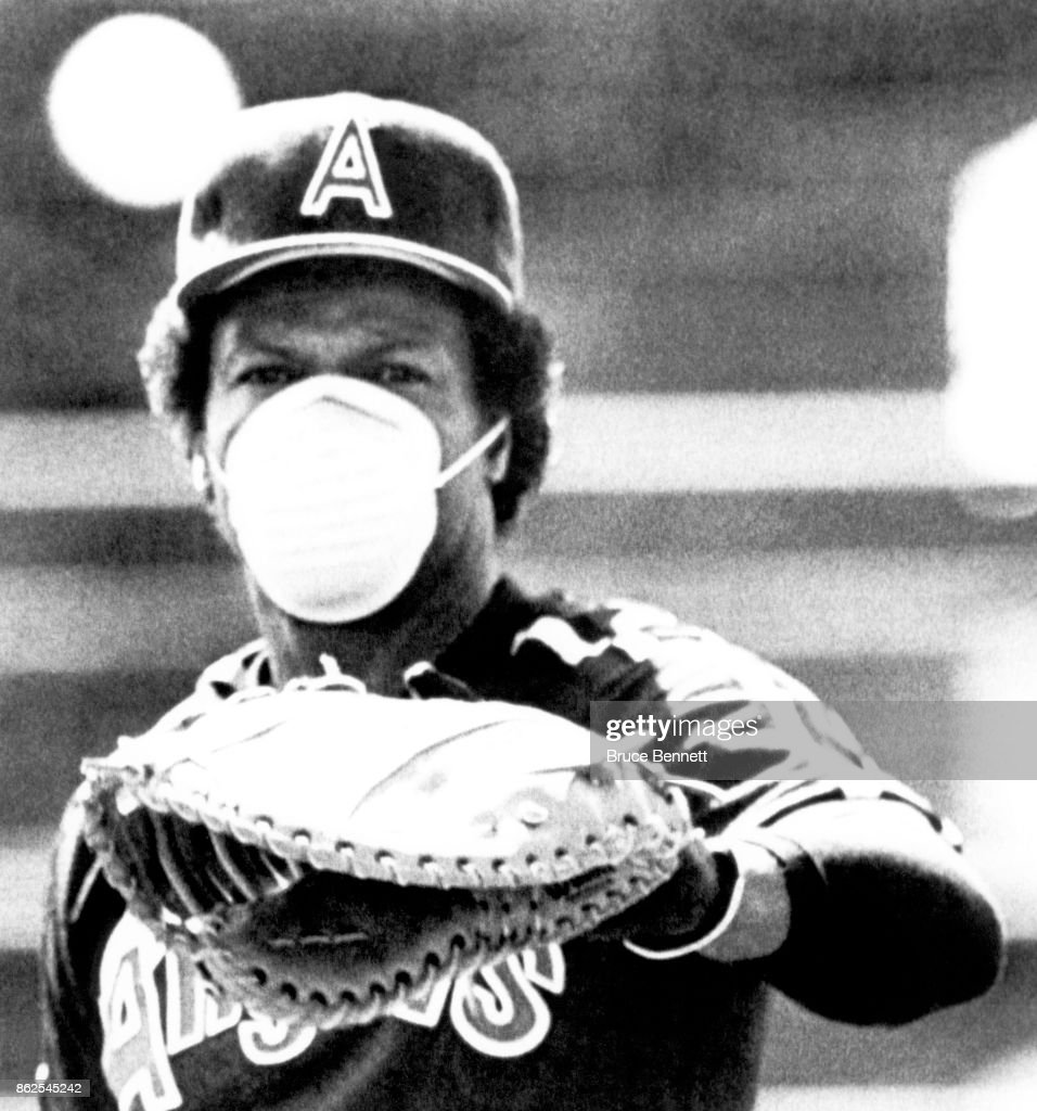 Rod Carew #29 of the California Angels wears an air filter mask as he is allergic to the dust and grass before an MLB Spring Training game on March 8, 1983 in Casa Grande, Arizona.