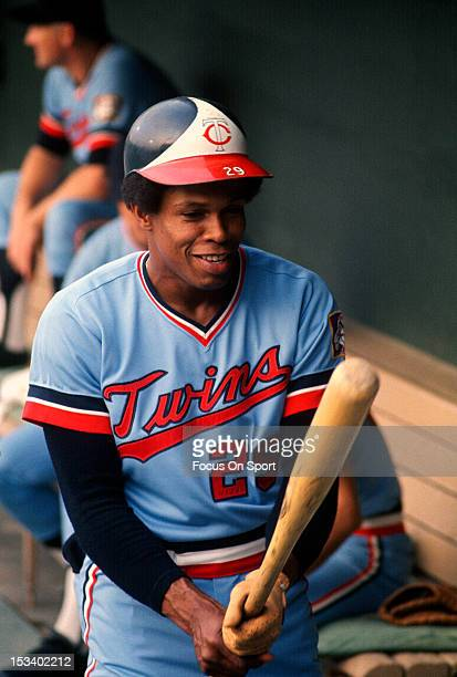 Rod Carew of the Minnesota Twins gets a feel for his bat in the dugout during an Major League Baseball game circa 1974 Carew played for the Twins...
