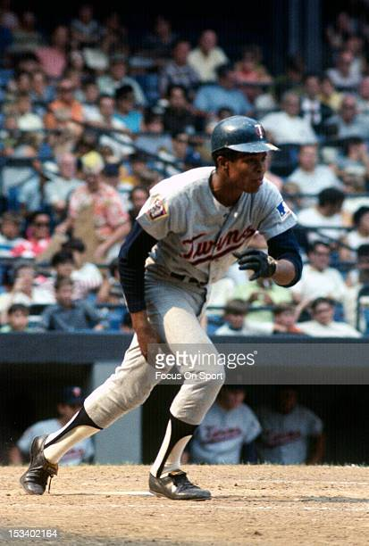 Rod Carew of the Minnesota Twins puts the ball in play and runs towards first base against the New York Yankees during an Major League Baseball game...