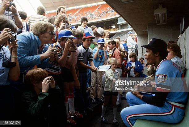 Rod Carew of the Minnesota Twins signs autographs for fans before the start of an Major League Baseball game circa 1972 Carew played for the Twins...