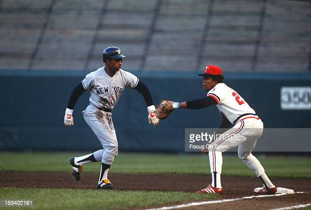 Rod Carew of the Minnesota Twins takes the throw over at first base as Willie Randolph of the New York Yankees gets back safely during an Major...