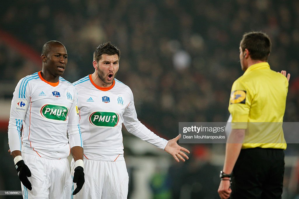 <a gi-track='captionPersonalityLinkClicked' href=/galleries/search?phrase=Rod+Fanni&family=editorial&specificpeople=684945 ng-click='$event.stopPropagation()'>Rod Fanni</a> (L) and Andre Pierre Gignac of Marseille react to referee <a gi-track='captionPersonalityLinkClicked' href=/galleries/search?phrase=Stephane+Lannoy&family=editorial&specificpeople=2274380 ng-click='$event.stopPropagation()'>Stephane Lannoy</a> after he gives a penalty to PSG during the French Cup match between Paris Saint-Germain FC and Marseille Olympic OM at Parc des Princes on February 27, 2013 in Paris, France.
