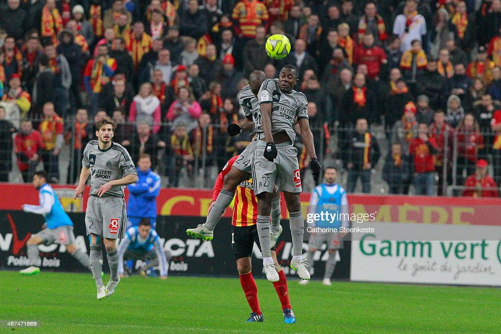 Rod Fanni and Giannelli Imbula of Olympique de Marseille try to get the ball during the game between RC Lens and Olympique de Marseille at Stade de...