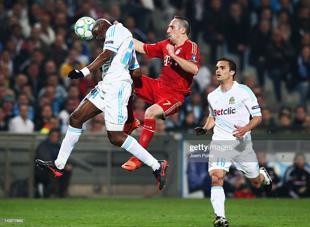 Rod Fanni of Marseille and Franck Ribery of Muenchen battle for the ball during the UEFA Champions League Quarter Final first leg match between...