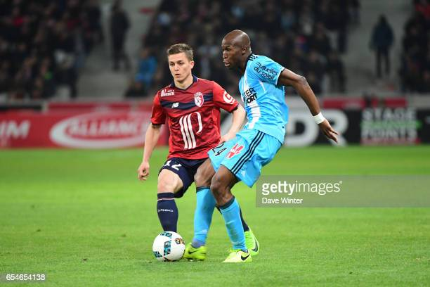 Rod Fanni of Marseille and Nicolas De Preville of Lille during the Ligue 1 match between Lille OSC and Olympique de Marseille at Stade Pierre Mauroy...