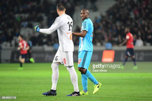 Rod Fanni of Marseillemakes a point to Yohann Pele of Marseille during the Ligue 1 match between Lille OSC and Olympique de Marseille at Stade Pierre...