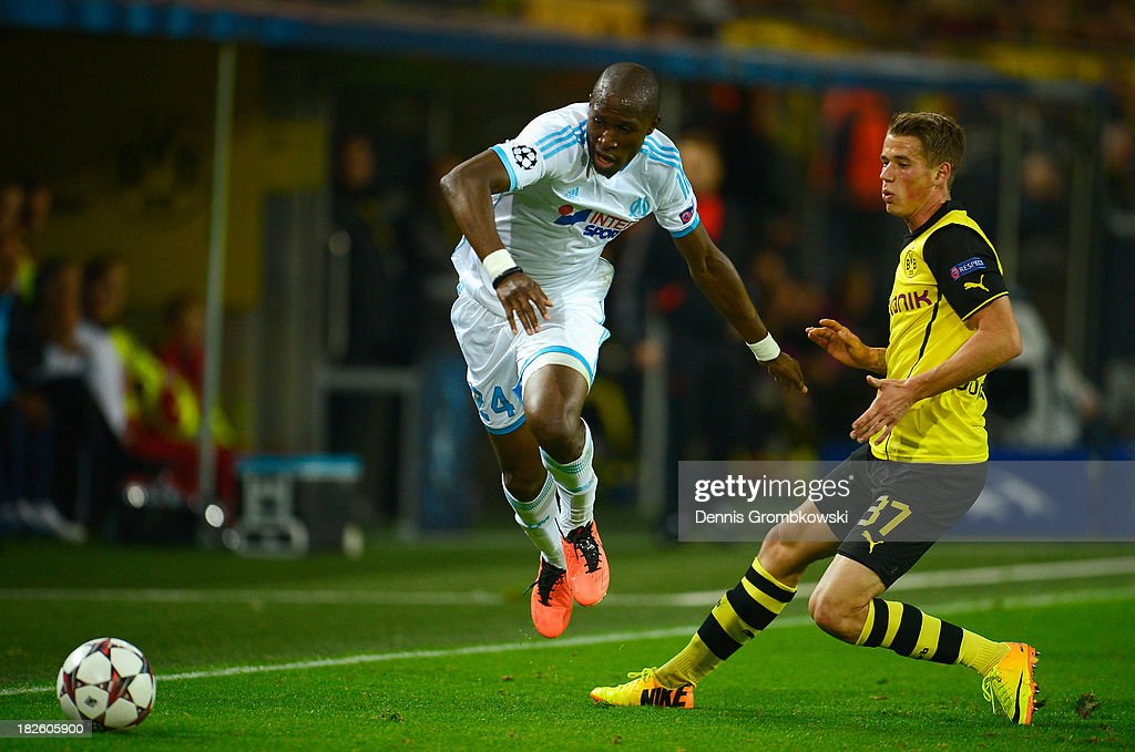 Rod Fanni of Olympique Marseille avoids a challenge from Eric Durm of Borussia Dortmund during the UEFA Champions League Group F match between...