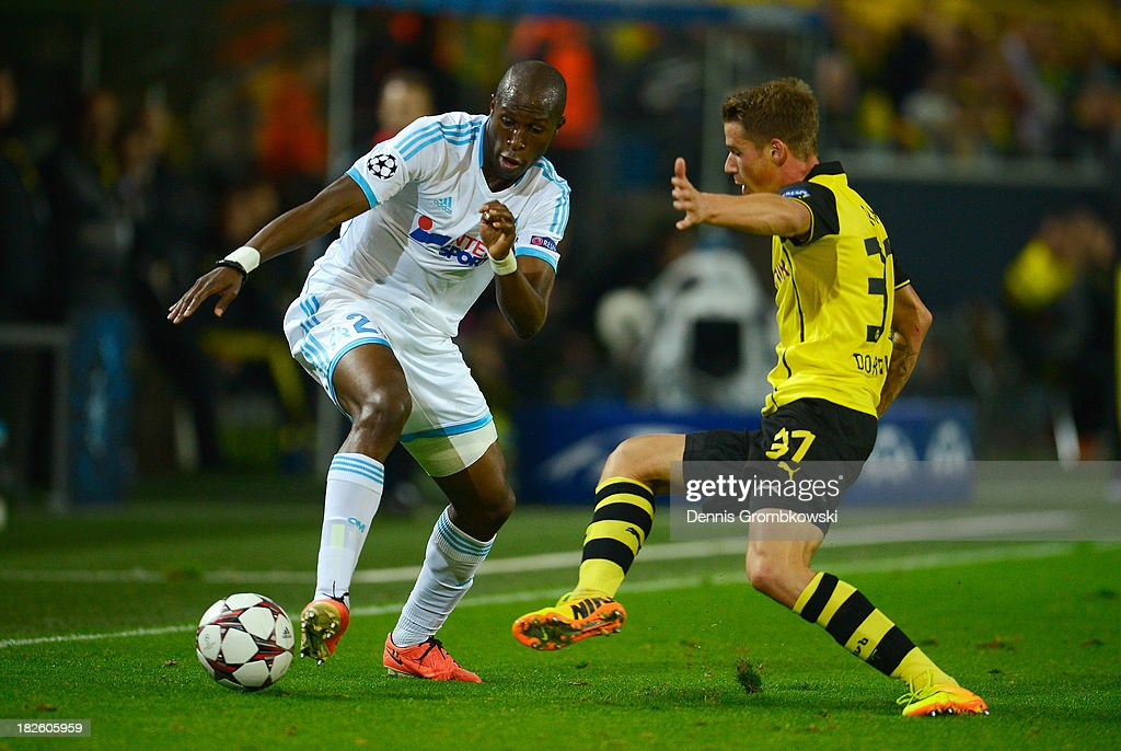 Rod Fanni of Olympique Marseille is challenged by Eric Durm of Borussia Dortmund during the UEFA Champions League Group F match between Borussia...