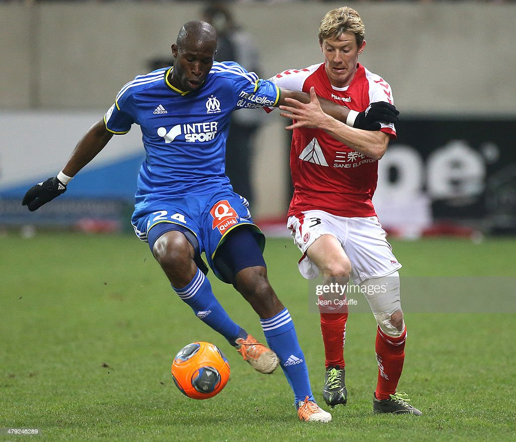 Rod Fanni of OM and Franck Signorino of Stade de Reims in action during the french Ligue 1 match between Stade de Reims and Olympique de Marseille at...