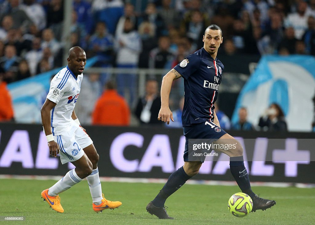 Rod Fanni of OM and Zlatan Ibrahimovic of PSG in action during the French Ligue 1 match between Olympique de Marseille and Paris SaintGermain at New...