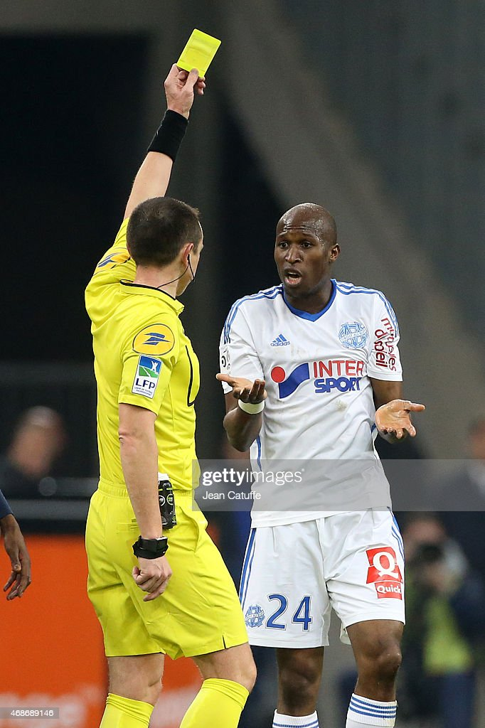 Rod Fanni of OM is shown a yellow card by referee Ruddy Buquet during the French Ligue 1 match between Olympique de Marseille and Paris SaintGermain...