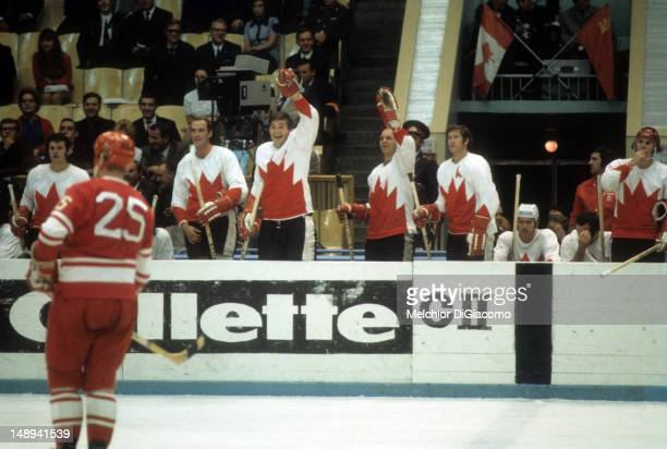 Rod Gilbert Bill White Pete Mahovlich Dennis Hull Jean Ratelle Red Berenson and Paul Henderson of Canada look on from the bench during their game...