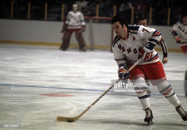 Rod Gilbert of the New York Rangers skates on the ice during an NHL game against the Montreal Canadiens circa 1972 at the Madison Square Garden in...
