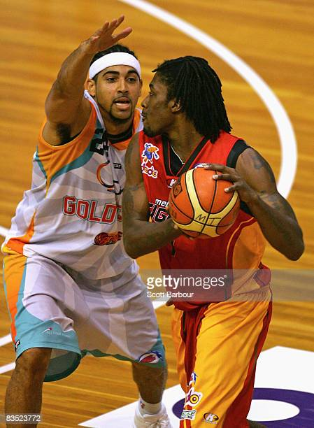 Rod Grizzard of the Tigers and Luke Whitehead of the Blaze in action during the round seven NBL match between the Melbourne Tigers and the Gold Coast...