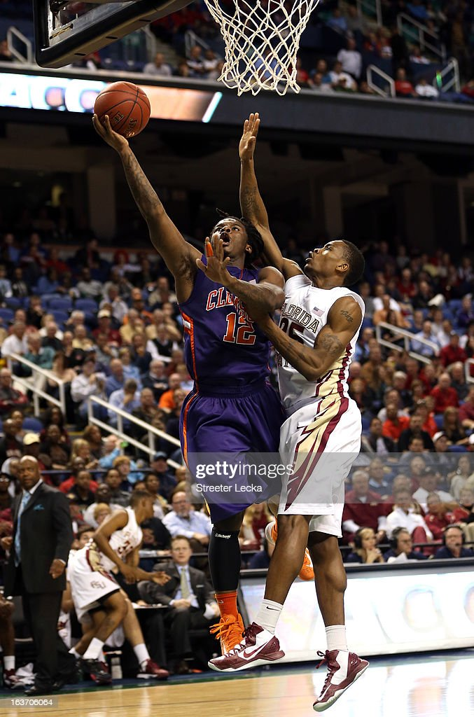 Rod Hall #12 of the Clemson Tigers goes to the basket against Aaron Thomas #25 of the Florida State Seminoles during the first round of the Men's ACC Basketball Tournament at Greensboro Coliseum on March 14, 2013 in Greensboro, North Carolina.