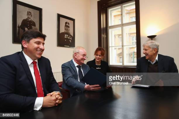 Rod Laver of Australia unveils a commemorative stamp with Martin Elkan Director General of the Czech Post and former Czech player Jan Kodes ahead of...