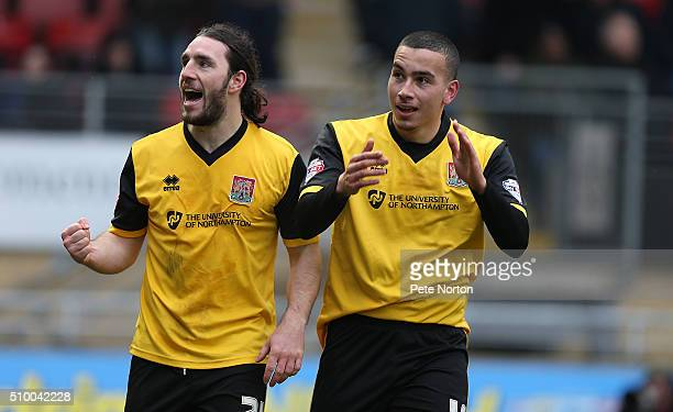 Rod McDonald of Northampton Town celebrates with JohnJoe O'Toole after scoring his sides first goal during the Sky Bet League Two match between...