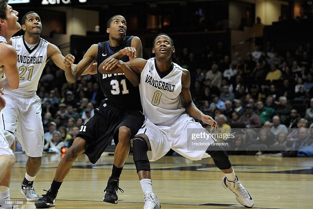 Rod Odom #0 and Sheldon Jeter #21 of the Vanderbilt Commodores play against Kameron Woods #31 of the Butler Bulldogs at Memorial Gym on December 29, 2012 in Nashville, Tennessee.