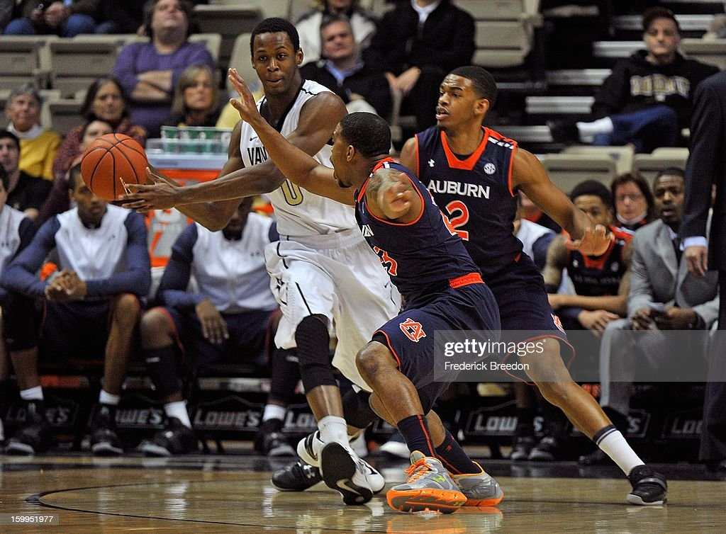 Rod Odom #0 is double teamed by Frankie Sullivan #23 and Allen Payne #2 of the Auburn Tigers at Memorial Gym on January 23, 2013 in Nashville, Tennessee.
