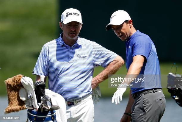 Rod Pampling of Australia and Rory McIlroy of Northern Ireland chat on the 16th tee during the final round of the Travelers Championship on June 25...