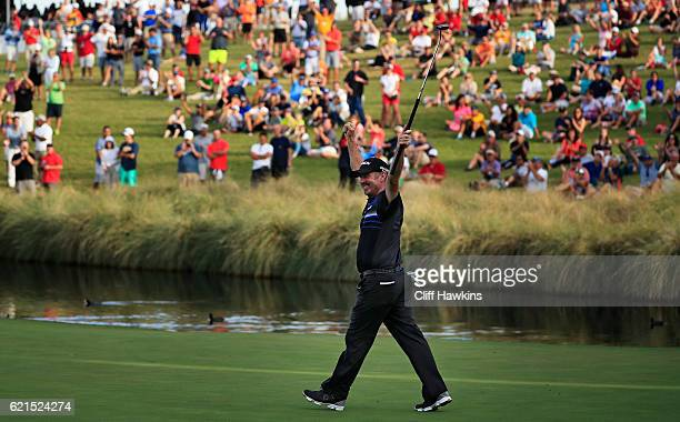 Rod Pampling of Australia celebrates after putting for birdie to win on the 18th green during the final round of the Shriners Hospitals For Children...