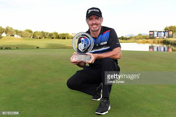 Rod Pampling of Australia celebrates with the winner's trophy after the final round of the Shriners Hospitals For Children Open on November 6 2016 in...