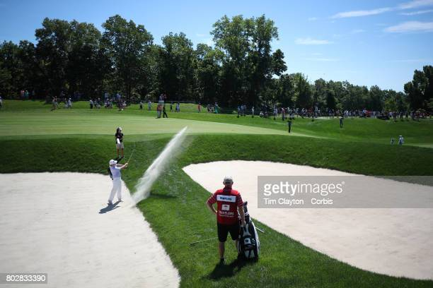 Rod Pampling of Australia drives out of a sand trap on the thirteenth during the fourth round of the Travelers Championship Tournament at the TPC...