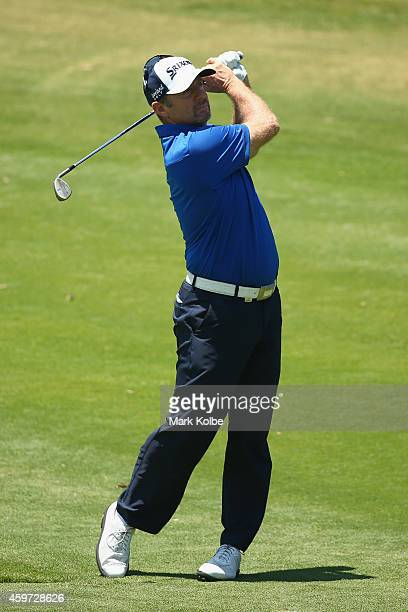 Rod Pampling of Australia hits an approach shot on the 7th hole during day four of the 2014 Australian Open at The Australian Golf Course on November...
