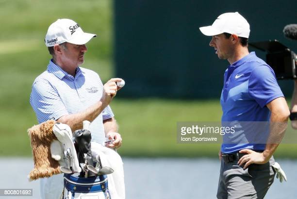 Rod Pampling of Australia makes a point with Rory McIlroy of Northern Ireland during the final round of the Travelers Championship on June 25 at TPC...