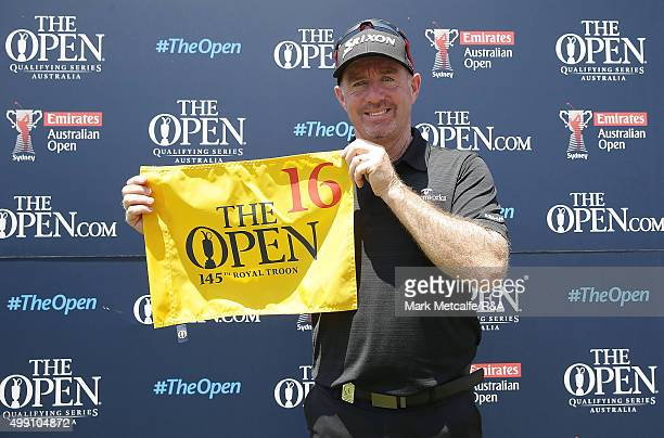 Rod Pampling of Australia poses for a photo with his flag after qualifying for the 2015 British Open during day four of the 2015 Australian Open at...