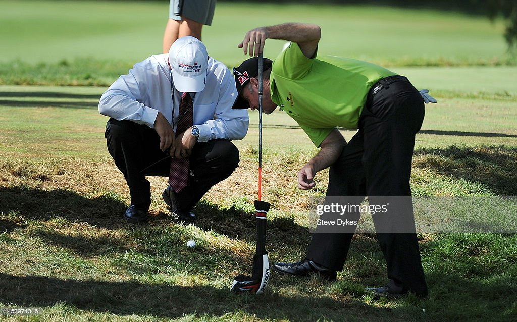 Rod Pampling of Australia takes a look at his ball with a rules official after he drive on the 11th hole landed on the 10th hole tee box during the second round of the WinCo Foods Portland Open on August 22, 2014 in North Plains, Oregon.