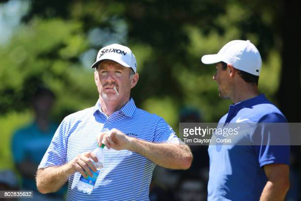 Rod Pampling of Australia with Rory McIlroy of Northern Ireland during the fourth round of the Travelers Championship Tournament at the TPC River...