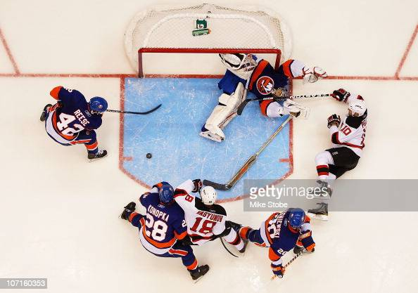 Rod Pelley of the New Jersey Devils is denied by goaltender Rick DiPietro of the New York Islanders on November 26 2010 at Nassau Coliseum in...