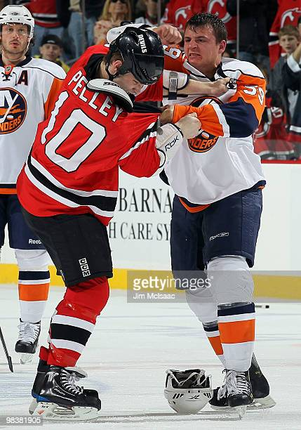 Rod Pelley of the New Jersey Devils trades punches with Michael Haley of the New York Islanders during their second period fight at the Prudential...