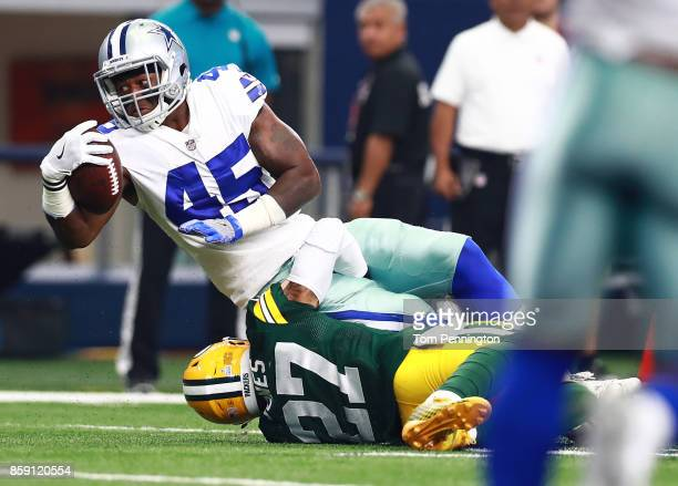 Rod Smith of the Dallas Cowboys gets takcled on the run by Josh Jones of the Green Bay Packers in the first half of a football game at ATT Stadium on...