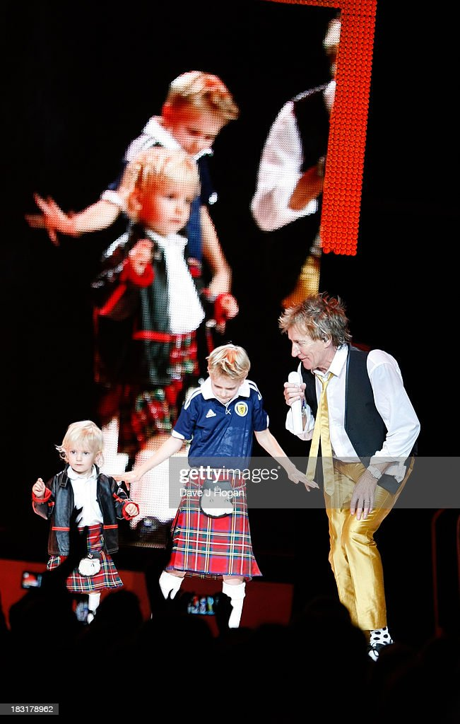 Rod Stewart and his sons Alastair Stewart and younger brother Aiden Stewart perform live on stage at The Hydro on October 5, 2013 in Glasgow, Scotland.