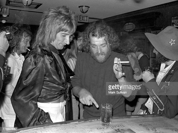 Rod Stewart and Joe Cocker discuss a drink at party for Bad Company at Mayfair Theatre in Santa Monica CA 1975 Various Locations Mark Sullivan 70's...