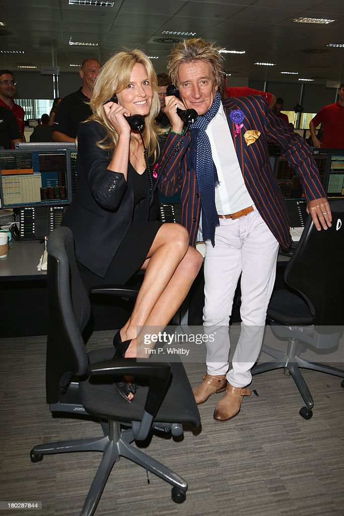 <a gi-track='captionPersonalityLinkClicked' href=/galleries/search?phrase=Rod+Stewart&family=editorial&specificpeople=160467 ng-click='$event.stopPropagation()'>Rod Stewart</a> and <a gi-track='captionPersonalityLinkClicked' href=/galleries/search?phrase=Penny+Lancaster&family=editorial&specificpeople=202837 ng-click='$event.stopPropagation()'>Penny Lancaster</a> on the trading floor at the BGC Charity Day 2013 at BGC Partners on September 11, 2013 in London, England.