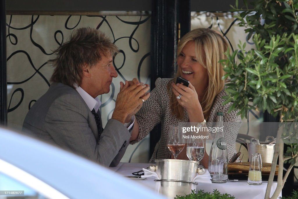<a gi-track='captionPersonalityLinkClicked' href=/galleries/search?phrase=Rod+Stewart&family=editorial&specificpeople=160467 ng-click='$event.stopPropagation()'>Rod Stewart</a> and <a gi-track='captionPersonalityLinkClicked' href=/galleries/search?phrase=Penny+Lancaster&family=editorial&specificpeople=202837 ng-click='$event.stopPropagation()'>Penny Lancaster</a> seen at Scott's Restaurant on June 25, 2013 in London, England.