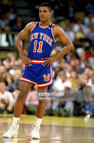 Rod Strickland of the New York Knicks stands on the court during an NBA game against the Los Angeles Lakers at the Great Western Forum in Los Angeles...