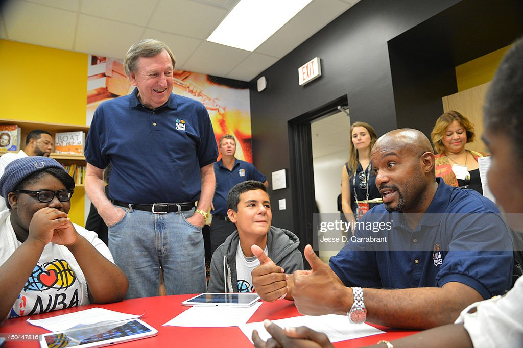Rod Thorn, President of Basketball Operations with the NBA and Legend Tim Hardaway of the Miami Heat interacts with the kid at the 2014 NBA Finals Legacy Project as part of the 2014 NBA Finals on June 11, 2014 at the Little Haiti Cultural Complex in Miami, Florida.