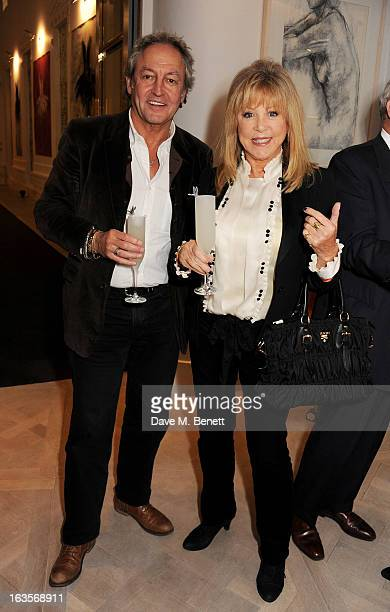 Rod Weston and Pattie Boyd attend the launch of Louise Fennell's new book 'Fame Game' at Grace Belgravia on March 12 2013 in London England