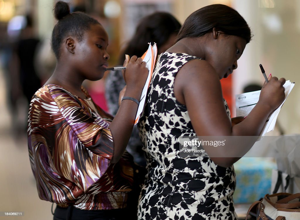 Rodacheca Nelson(L) and Samuella Augustin fill out job application forms as they apply for jobs during a job fair at Sawgrass Mills on October 11, 2013 in Sunrise, Florida. As the holiday season approaches many of the roughly 50 retailers at the job fair including Banana Republic, J.Crew Factory, Victoria's Secret and Calvin Klein are starting to hire people for seasonal work as well as continuing to look for qualified full time employees.