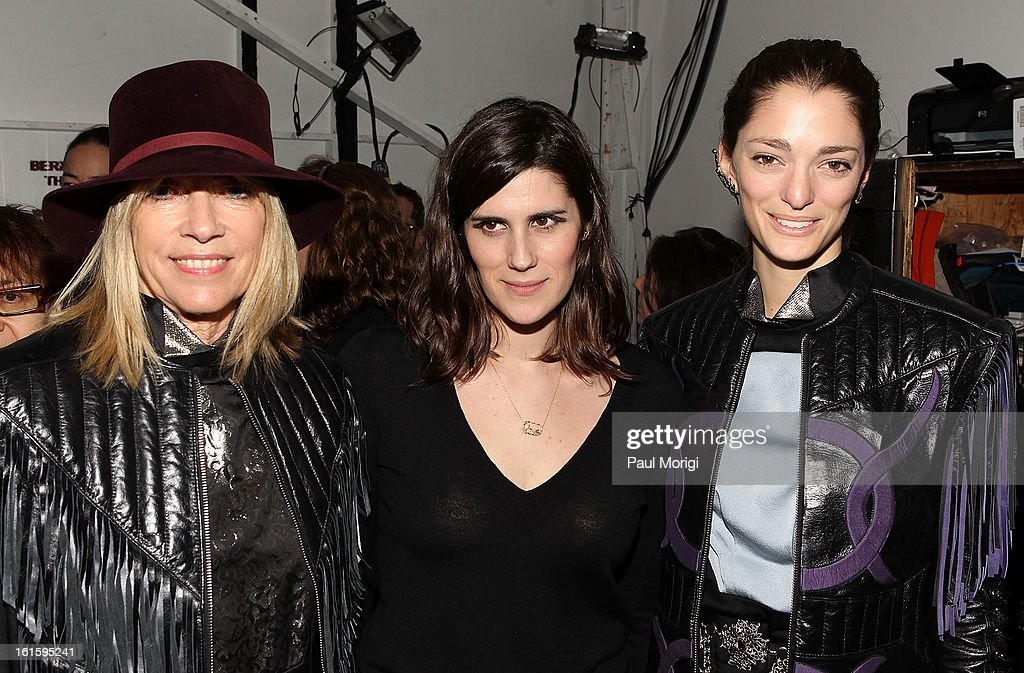 Rodarte designer Laura Mulleavy (C) poses for a photo with Kim Gordon (L) and Sophia Sanchez backstage at Rodarte during Fall 2013 Mercedes-Benz Fashion Week on February 12, 2013 in New York City.