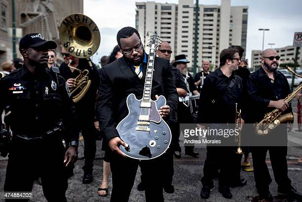 Rodd Bland son of blues legend Bobby Bland carries Lucille one of BB King's beloved guitars at the front of the processional down Beale Street...